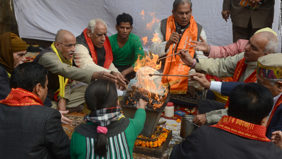 Indian demonstrators perform a prayer ritual in memory of a gang-rape victim in New Delhi on Monday, December 31. The family of the victim said they would not rest until her killers are hanged as they spoke of their own pain and trauma over a crime that has united the country in grief.