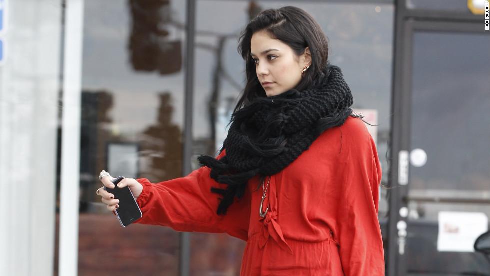 Vanessa Hudgens keeps her phone handy on December 30.