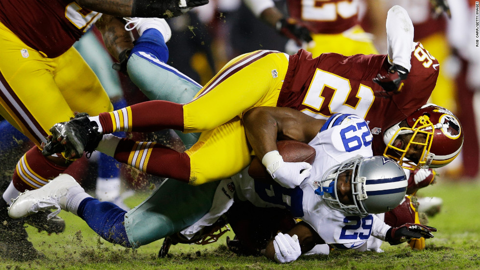 DeMarco Murray of the Dallas Cowboys is tackled during Sunday night's game against the Washington Redskins.