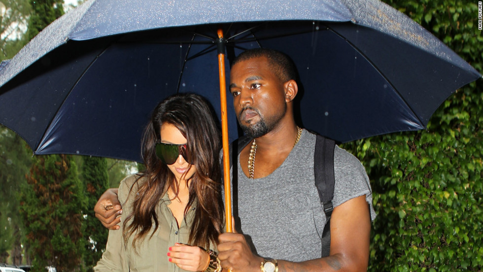 When Kim and Kanye took a romantic, rainy stroll in Miami in October 2012, everything seemed PG at first ...