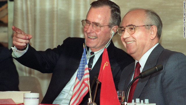 President George H.W. Bush shares a joke with Soviet leader Mikhail Gorbachev on December 3, 1989.