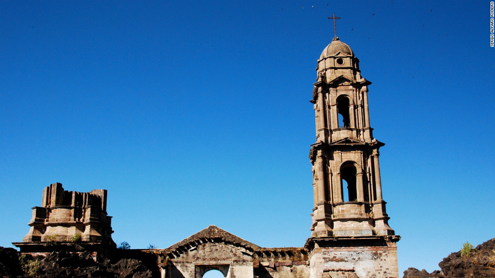 The surviving San Juan Parangaricutiro ruins in Michoacán, Mexico. In 1943, an explosive volcano eventually buried San Juan Parangaricutiro and another village.