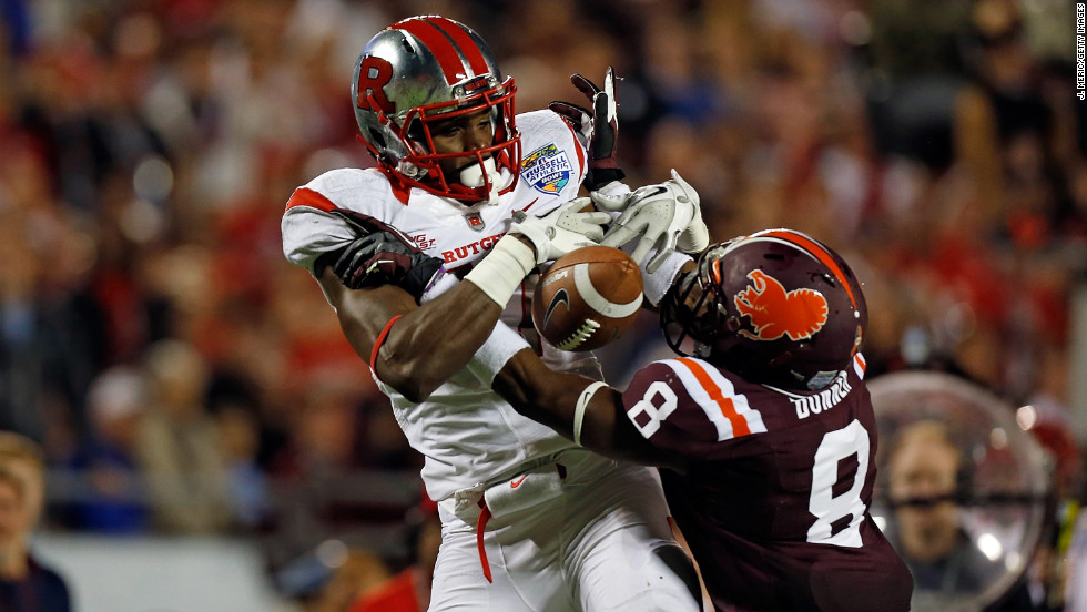 Brandon Coleman of the Scarlet Knights fumbles as Detrick Bonner of the Hokies breaks up the pass on December 28.