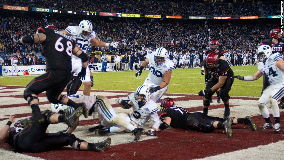 Kyle Van Noy of the BYU Cougars recovers a fumble and scores a touchdown after sacking the quarterback in the second half of the game against the San Diego State Aztecs on December 20.