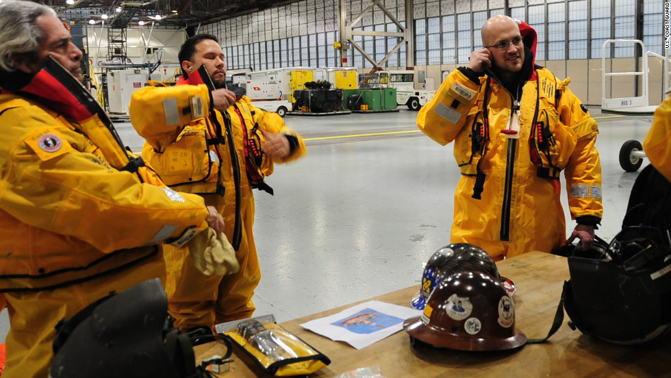 Rescue workers prepare for the cold, windy conditions.