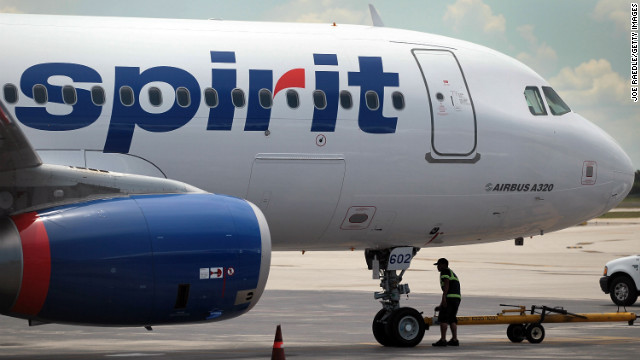 FORT LAUDERDALE, FL - JUNE 17:  A Spirit Airlines Inc. employee walks under a plane on the tarmac at the Fort Lauderdale International Airport after striking pilots agreed on June 16 to a new contract June 17, 2010 in Fort Lauderdale, Florida. The airline announced that planes will start flying as soon as this afternoon. The pilots walked out on June 12 in a dispute over pay and benefits with the Miramar, Florida discount airline.  (Photo by Joe Raedle/Getty Images)