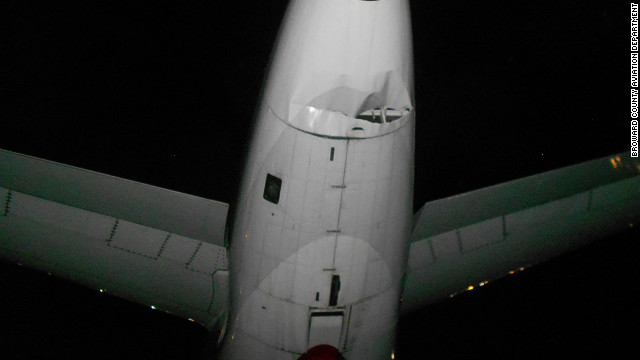 The tail of a US Airways plane shows damage caused by a collision with a Spirit Airlines plane, Monday.