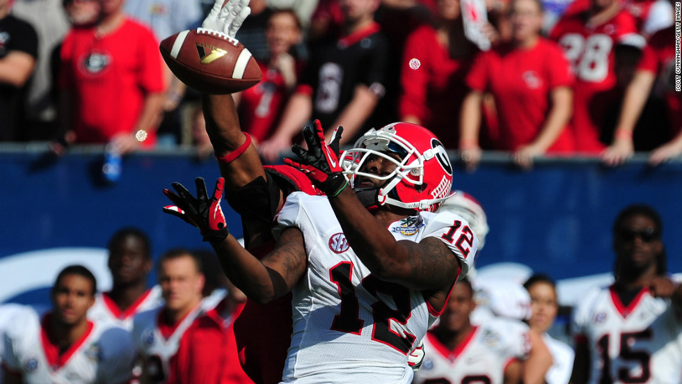 Tavarres King of the Georgia Bulldogs makes a catch for a touchdown against Andrew Green of the Nebraska Cornhuskers on January 1.