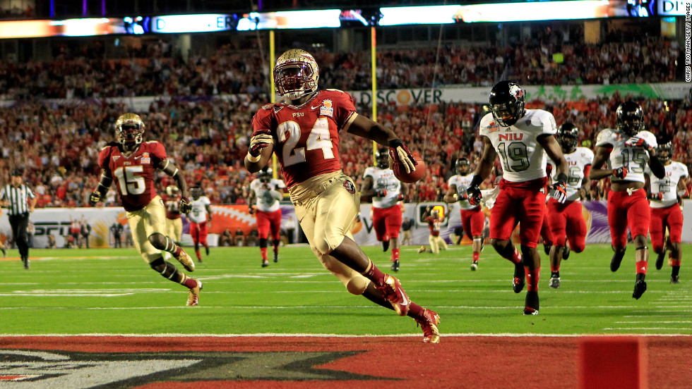 Lonnie Pryor of the Florida State Seminoles scores a 60-yard rushing touchdown in the first quarter against the Northern Illinois Huskies January 1.