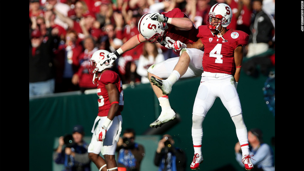 Josh Mauro and Blake Martinez of the Stanford Cardinal celebrate after stopping the Wisconsin Badgers on a fourth down in the first half on January 1.