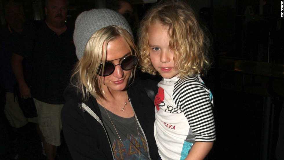 Ashlee Simpson carries son Bronx Mowgli at the airport on January 1.