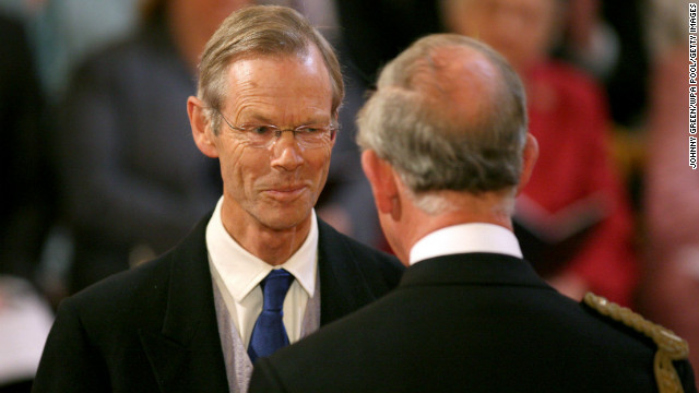 Cricket journalist Christopher Martin-Jenkins receives the MBE from Prince Charles at Buckingham Palace in May 2009 in London.