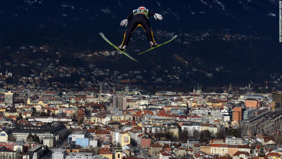 Richard Freitag of Germany soars over the skyline of Innsbruck, Austria, during the training round on Thursday, January 3.