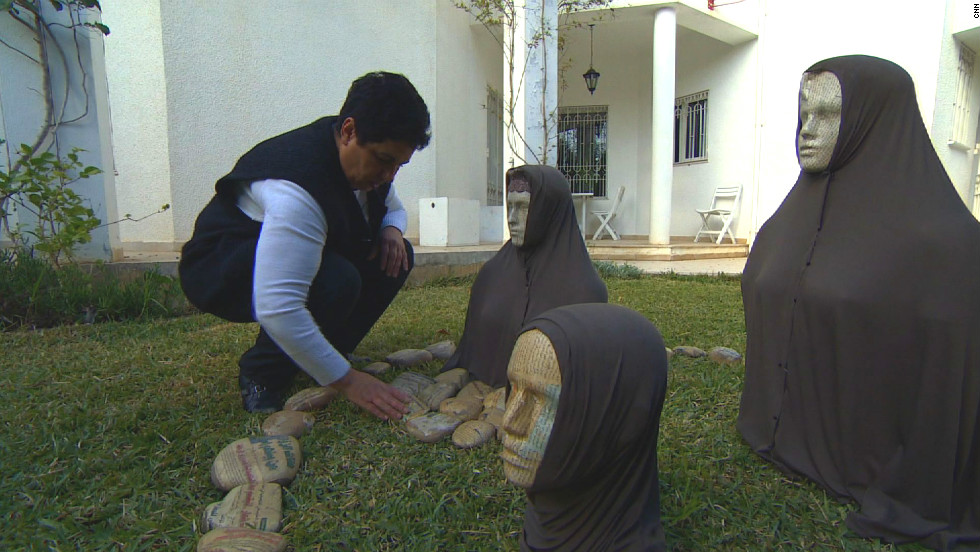 "Tunisian artist Nadia Jelassi and her installation ""Celui qui n'a pas ... (Anyone who has not ... ),"" which was interpreted by some Salafists as implying traditionally-dressed women should be stoned. Jelassi says the work is about ""trying to show two different ways to practice Islam -- one spiritual, and one closed."""