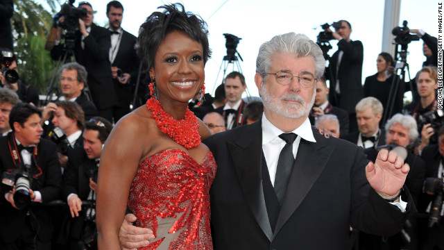 George Lucas, here with fiancee Mellody Hobson, has given Abrams his stamp of approval.