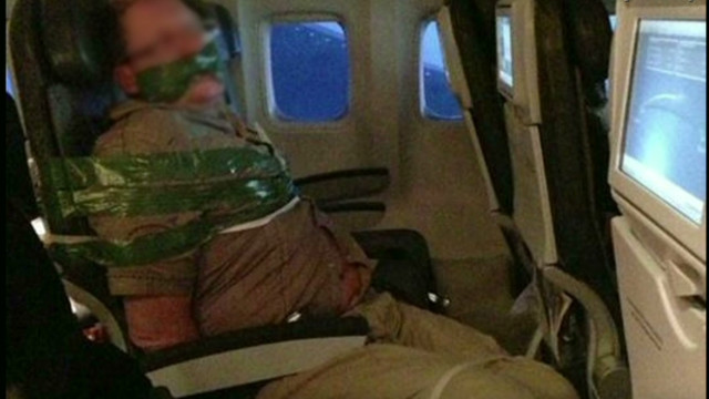Unruly passenger duct-taped to seat