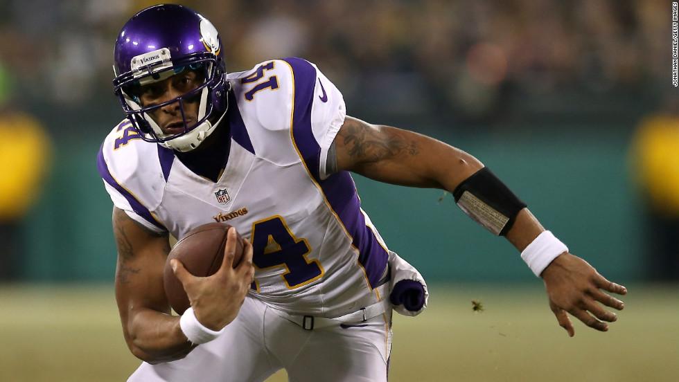 Minnesota quarterback Joe Webb looks to gain ground against the Packers.