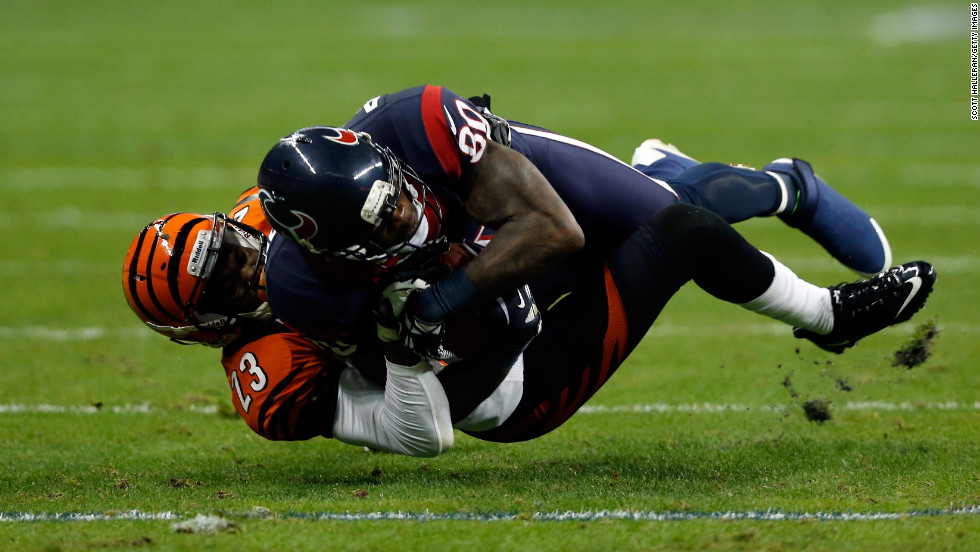 Andre Johnson of the Houston Texans makes a catch against Terence Newman of the Cincinnati Bengals during their AFC Wild Card Playoff Game at Reliant Stadium on Saturday in Houston.