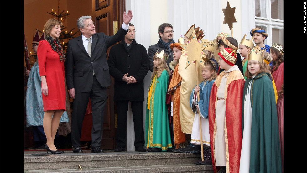 Child Epiphany carolers, known as Sternsinger in German, visit German President Joachim Gauck, second from left, and his partner, Daniela Schadt, left, at Bellevue presidential palace on January 6 in Berlin. The children, dressed as the Three Magi, walk from house to house in the days around January 6 singing carols and collecting money for needy children.