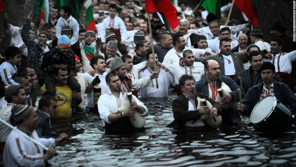 Men perform a traditional dance in the icy waters of the Tundzha River in the town of Kalofer, Bulgaria, as part of the Epiphany celebrations on Sunday. The dancers and the first to retrieve the cross thrown in the water are believed to have good health for the next year.
