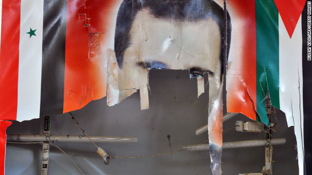 A tattered poster of Syrian President Bachar al-Assad is seen in the northern town of Ras al-Ain, close to the Turkish border, on November 10, 2012. The Syrian National Council says it will put its own proposals to delayed talks on broadening the base of the opposition, despite mounting frustration by other factions, and as deadly violence rages on.