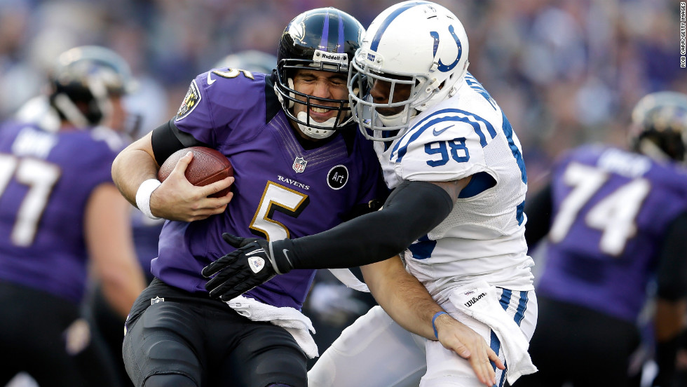 Joe Flacco of the Baltimore Ravens is sacked by Robert Mathis of the Indianapolis Colts on Sunday.