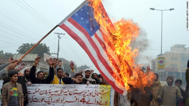 Demonstrators burn a U.S. flag during a protest in Multan on January 3, 2013, against drone attacks in Pakistan's tribal areas.