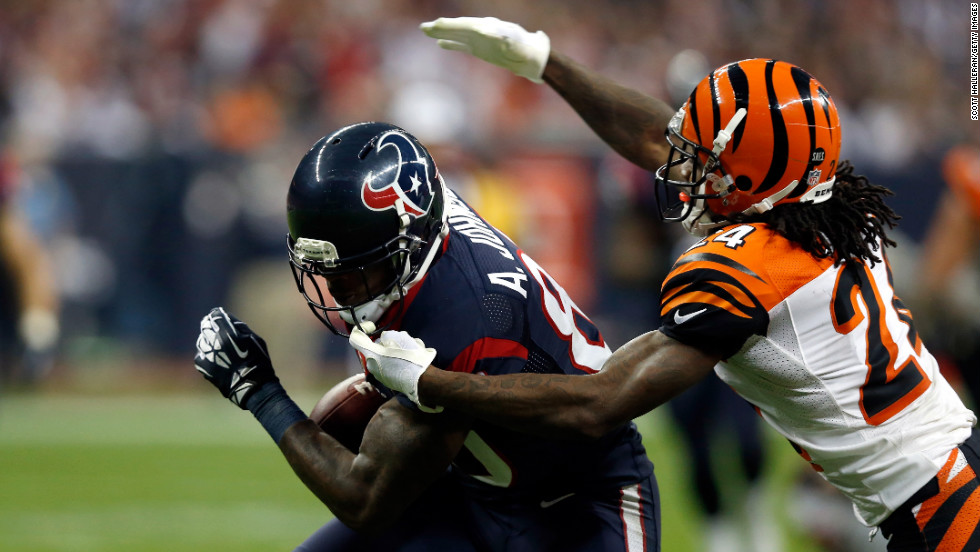 Houston' s Andre Johnson makes a reception against Adam Jones.