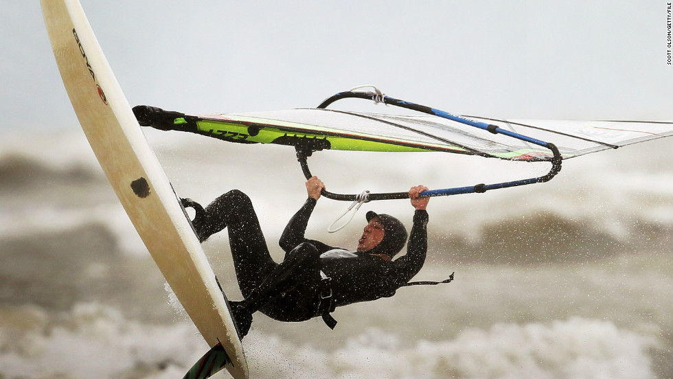 Visitors to Chicago can partake in myriad sailing and watersports activities on Lake Michigan. Here a windsurfer takes on the waves in rough conditions.
