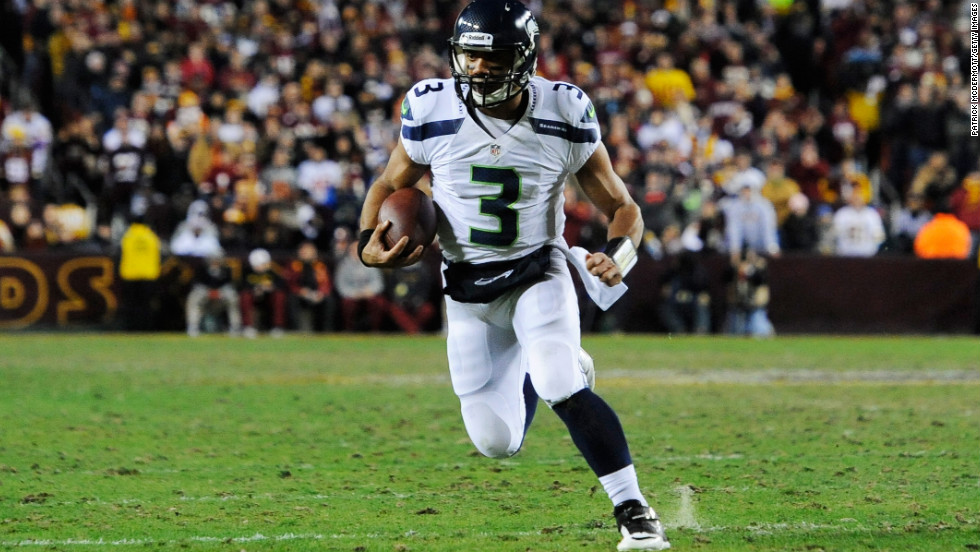 Russell Wilson of the Seattle Seahawks runs the ball for a first down on Sunday.