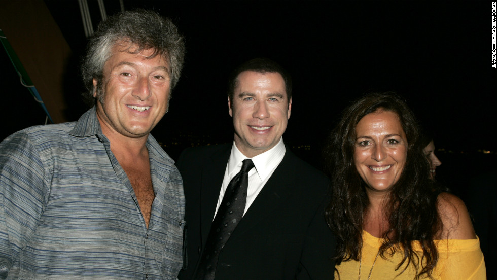 Vittorio Missoni and his sister, Angela, pose with actor John Travolta at the Venice Film Festival in 2004.