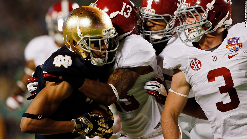 TJ Jones of Notre Dame is tackled by Alabama's Ty Reed.
