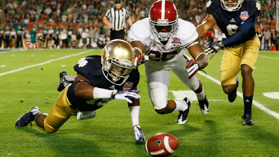 Davonte Neal of Notre Dame, left, fights Landon Collins of Alabama for a loose ball after muffing the punt in the second quarter.