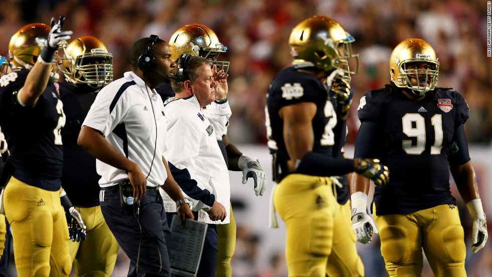 Notre Dame head coach Jim Kelly looks on from the sidelines.