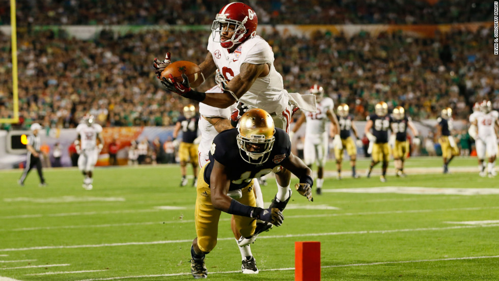 Ha'Sean Clinton-Dix of Alabama intercepts a pass intended for Notre Dame's DaVaris Daniels in the third quarter.