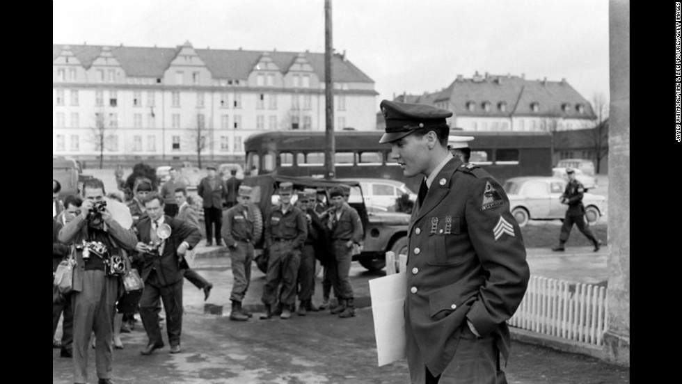 In 1958, as he was topping the musical charts, pop artist Elvis Presley was drafted in to the U.S. Army. He served for two years in Germany before he was honorably discharged and took to swinging his hips onstage again. In honor of his 77th birthday, Life magazine put together a gallery of photos from this period in the rock legend's life. Pictured, Sgt. Elvis Presley prepares to leave Germany in March 1960.