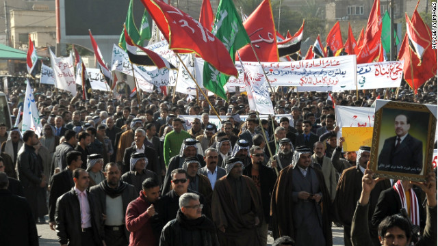 Iraqi protestors gather in support of Prime Minister Nuri al-Maliki in the city of Karbala, southwest of Baghdad, on January 8, 2013.