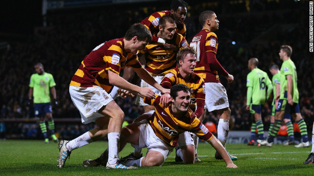 Bradford's players celebrate after Carl McHugh (grounded) scores their third against Aston Villa