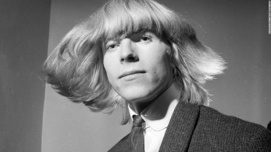 Bowie's hair and outfits shocked and awed for decades. Pictured, a young Bowie sports a Prince Valiant-esque do in March 1965, while he was still going by his birth name of Davy Jones. He changed his name to Bowie following the success of the Monkees and their lead singer Davy Jones.