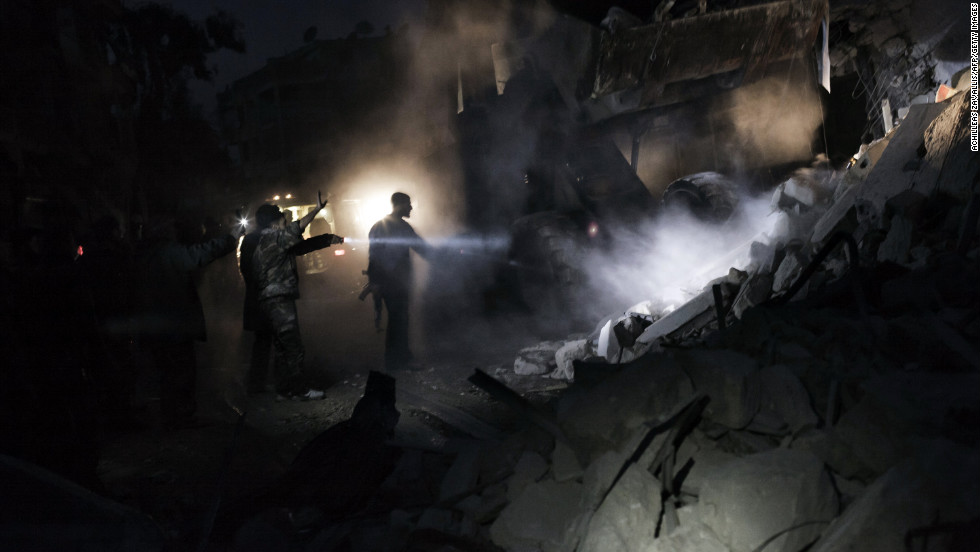 Syrians search for survivors in the rubble of a building targeted by a missile in Aleppo on January 7.