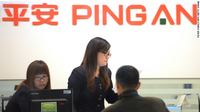 People are seen inside of a branch of Ping An Insurance in Shanghai on November 26, 2012.