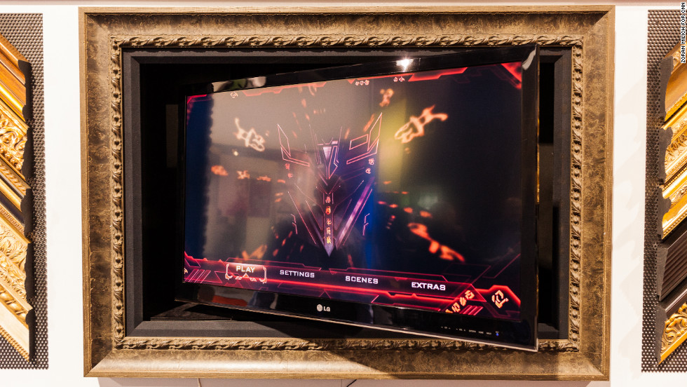 Movable television screens by Vutec sit in wooden picture frames and allow digital artwork to cover the screen when the TV is not being watched. Prices reach up to several thousand dollars, depending on size.