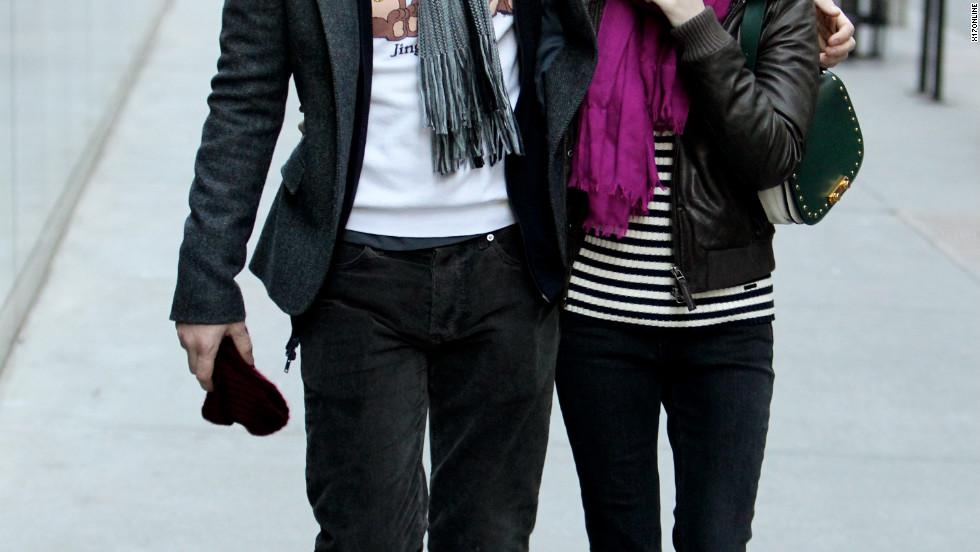 Actors Evan Peters and Emma Roberts walk together in NYC.