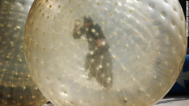 (File photo)  A woman plays in a Zorb ball in a park on April 24, 2011 in England.