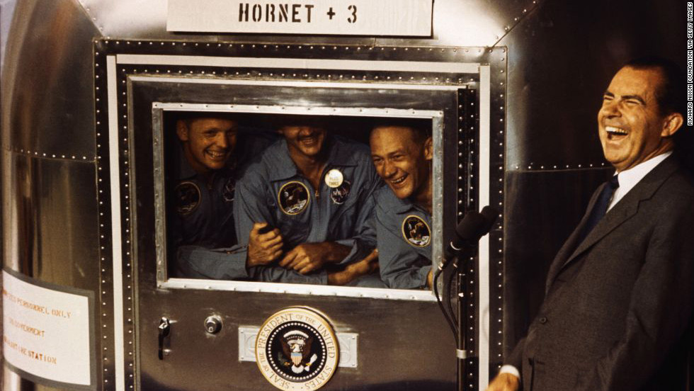 Apollo 11 astronauts Neil Armstrong, Michael Collins and Buzz Aldrin laugh with President Nixon aboard the USS Hornet on July 24, 1969. The president was on hand to greet the astronauts after their splashdown in the Pacific.