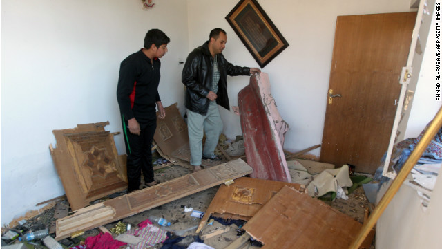 Iraqi inspect their house damaged by the explosion that killed at least three people on January 10, 2013, in the Hurriyah.