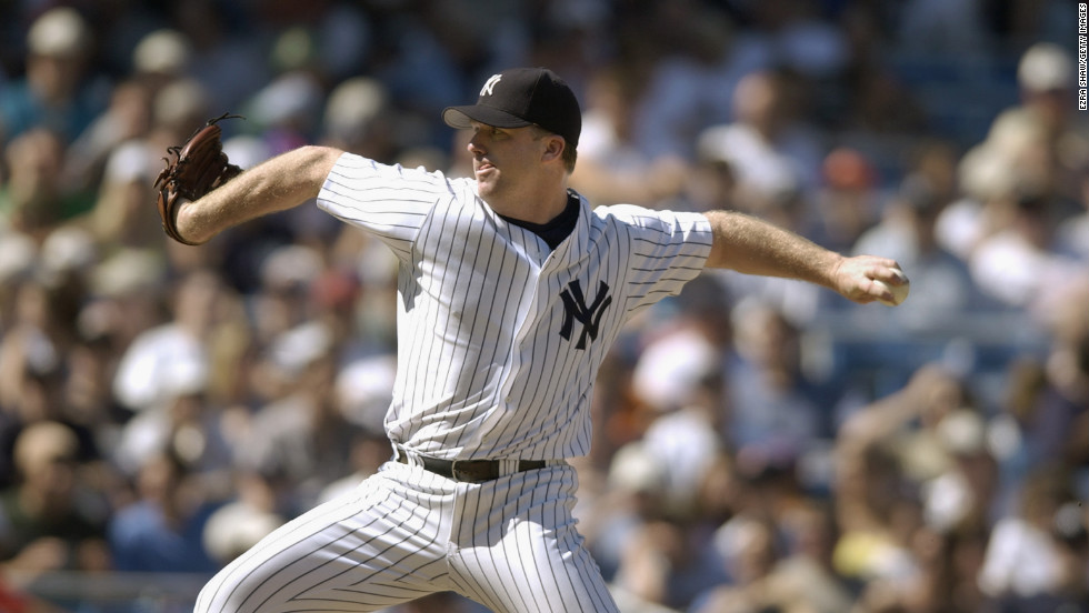 Mike Stanton of the New York Yankees pitches against the Boston Red Sox during a game at Yankee Stadium on June 2, 2002.
