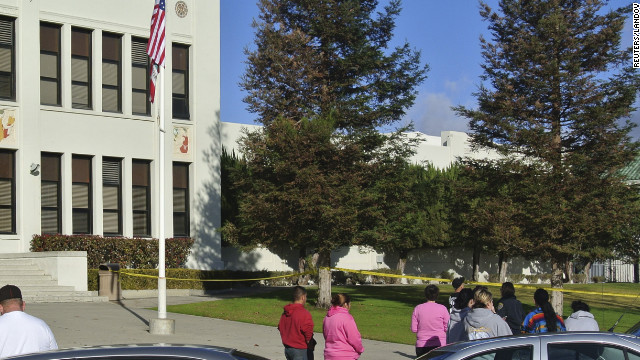 Bystanders wait outside police tape in front of Taft Union High School after a shooting incident on January 10.