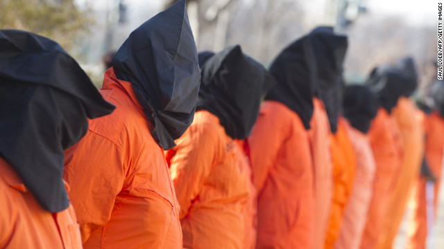 Wearing prison jumpsuits and hoods, protesters on January 8 on Capitol Hill demand the Guantanamo prison be closed.