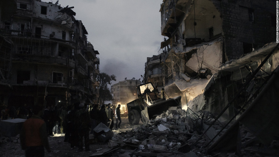 Syrians look for survivors amongst the rubble of a building targeted by a missile in the al-Mashhad neighborhood of Aleppo on Monday, January 7.